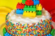 24 bold confetti cake with a fun topper