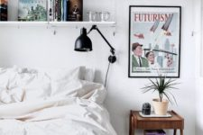 24 wall-mounted open shelving above the bed