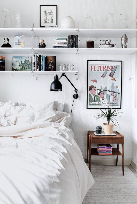 wall-mounted open shelving above the bed