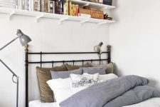 25 wall-mounted shelves under the ceiling to save some space
