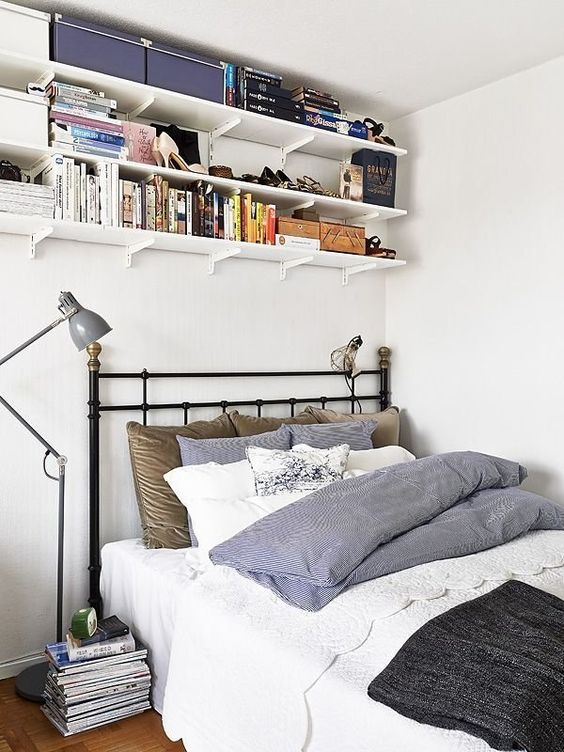 wall-mounted shelves under the ceiling to save some space
