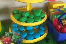 26 colorful macarons at a Lego birthday party