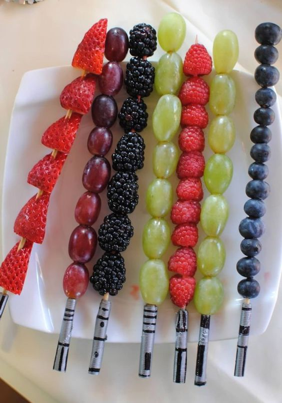 fruit lightsaber skewers are awesome for kids' parties