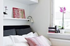 26 wall-mounted storage cabinets over the bed