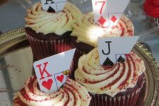 27 cupcakes topped with parts of cards