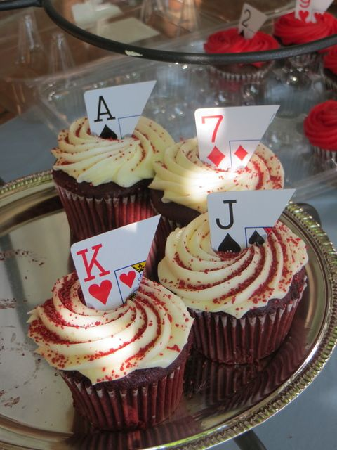 cupcakes topped with parts of cards