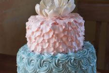27 pink and blue gender reveal cake with an edible flower