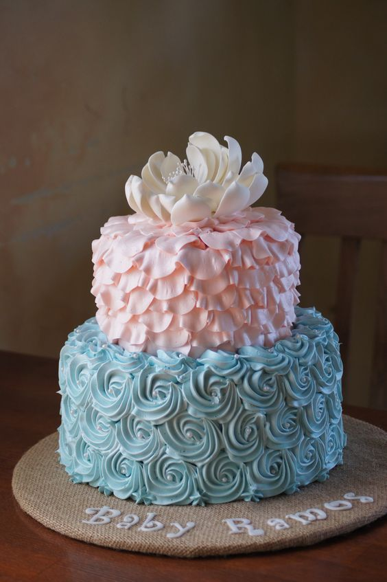 pink and blue gender reveal cake with an edible flower