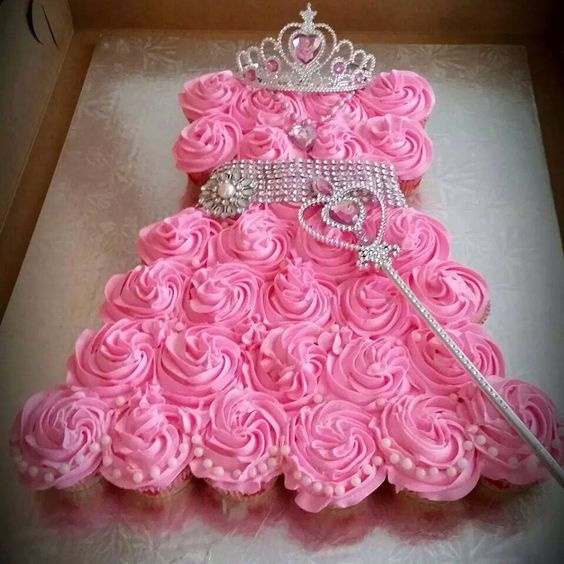 pink cupcakes with a wand, a tiara and a sash