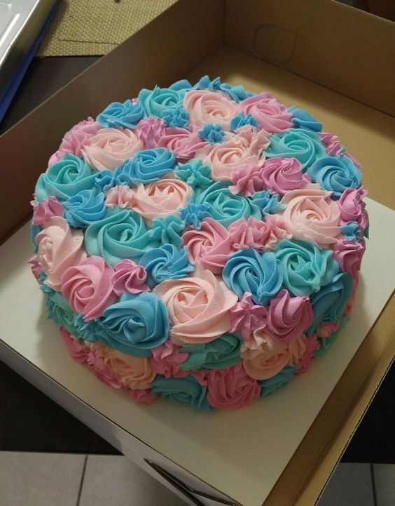pink and blue rosette party cake