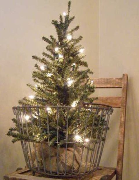 28 tree in an old egg basket, covered with lights