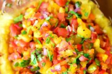 29 pineapple salsa served in a real pineapple