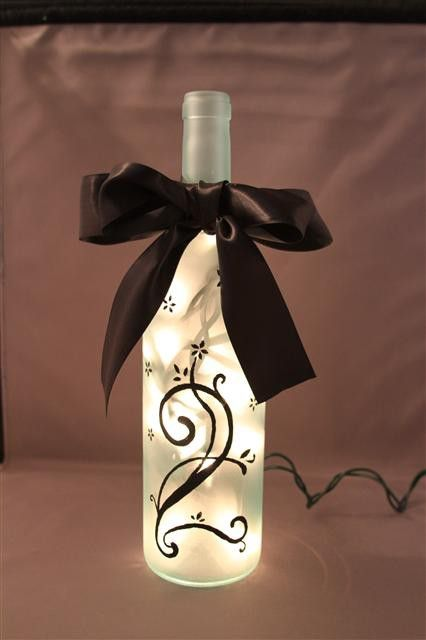 wine bottle with LEDs and silk ribbon