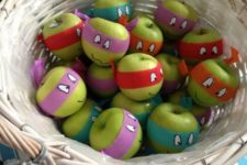 30 wrap green apples with paper masks with eyes painted