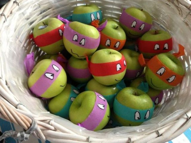 wrap green apples with paper masks with eyes painted