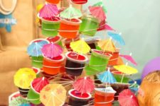 32 colorful jellos topped with cocktail umbrellas