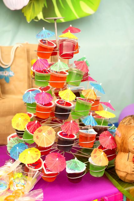colorful jellos topped with cocktail umbrellas