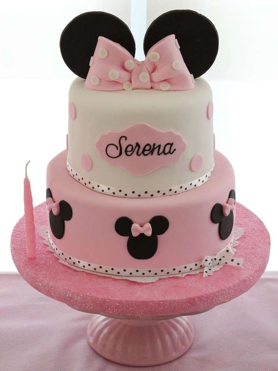 two tier party cake topped with ears and a bow