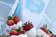33 strawberries in white chocolate with 'Frozen Hearts' printable