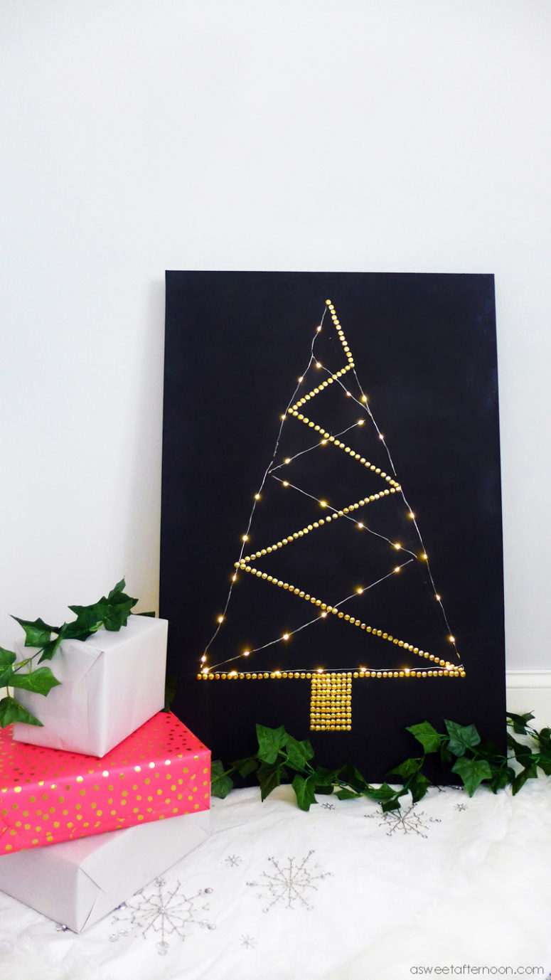 DIY lighted canvas Christmas tree (via www.asweetafternoon.com)