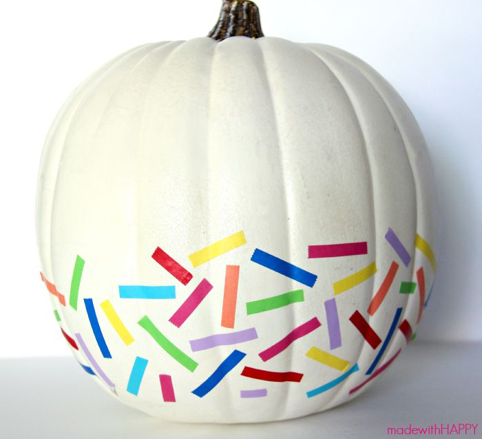 DIY washi tape pumpkin in rainbow colors (via www.madewithhappy.com)