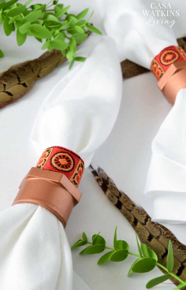 DIY PVC pipe napkin rings with ribbon (via www.homemadebycarmona.com)