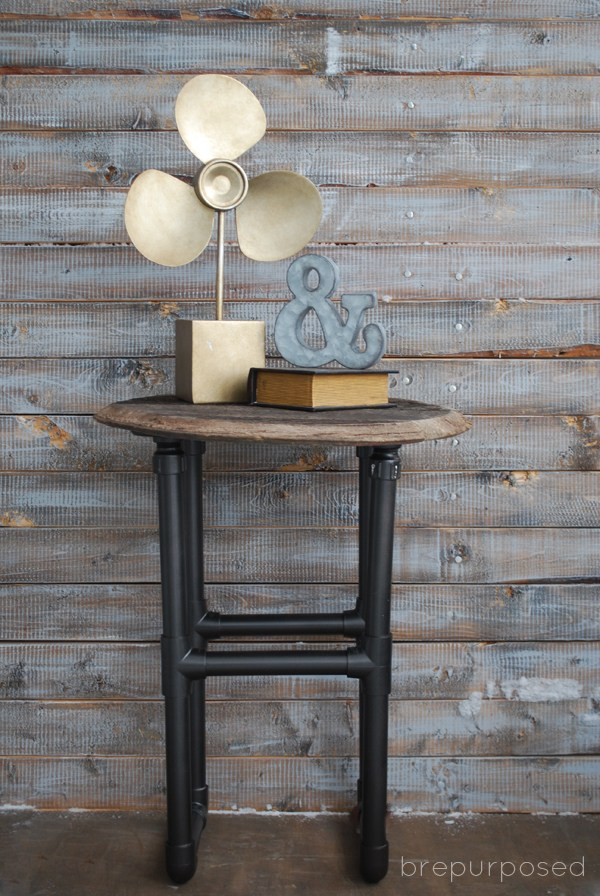 DIY industrial table of wood and PVC pipes (via brepurposed.porch.com)