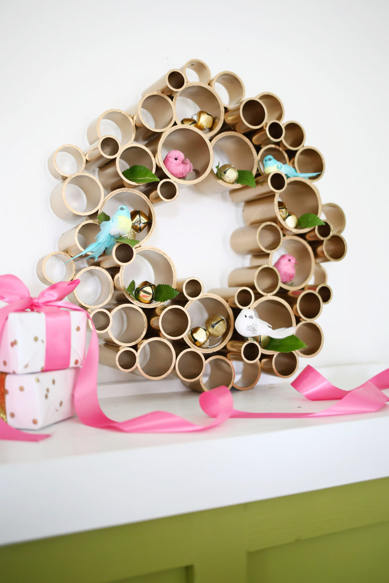 DIY PVC pipe wreath for any holiday (via www.abeautifulmess.com)