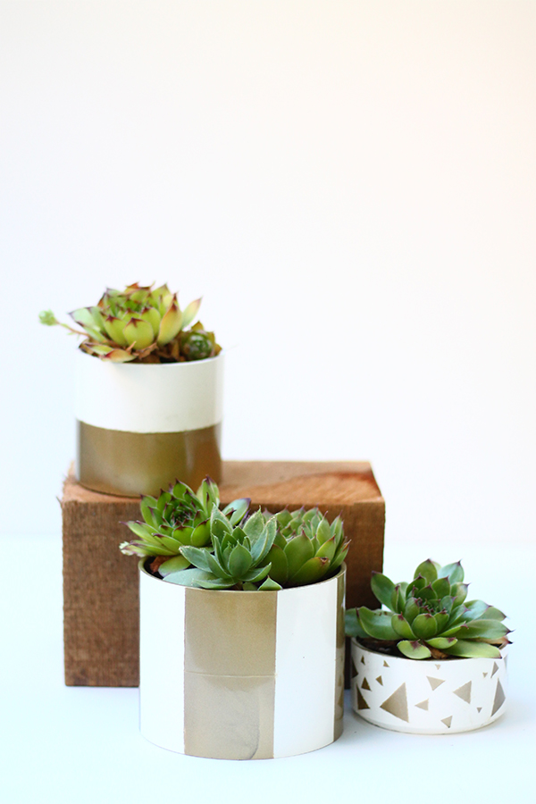 DIY metallic painted PVC pipe planter (via squirrellyminds.com)