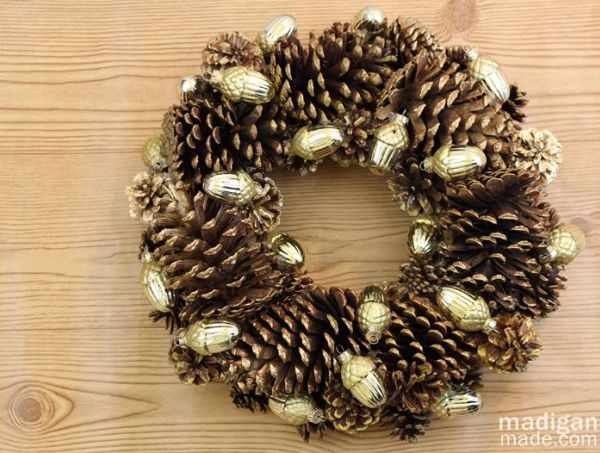 DIY gilded pinecone and ornament wreath  (via rosyscription.com)