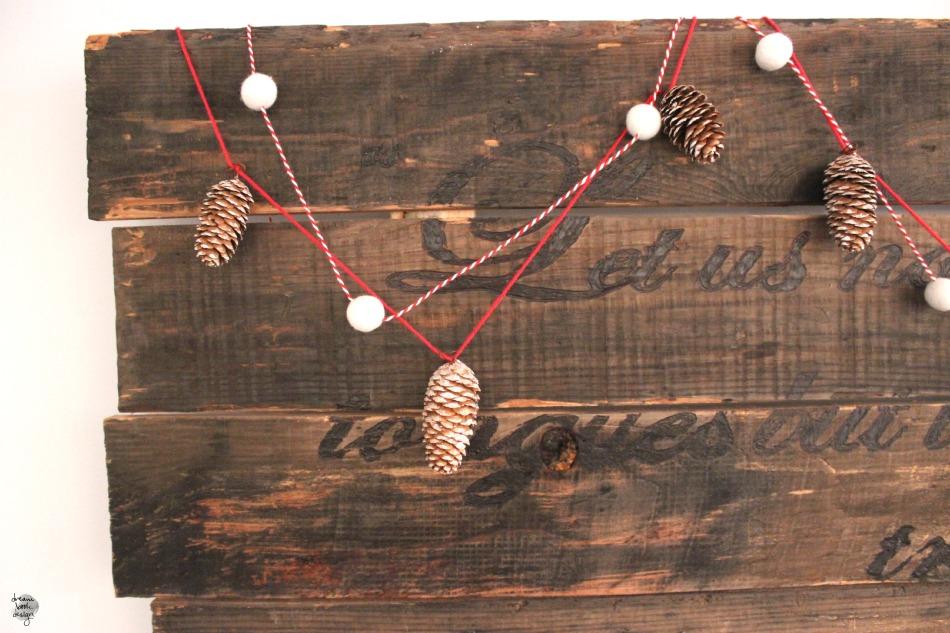 DIY Christmas garland of felt balls and faux pinecones