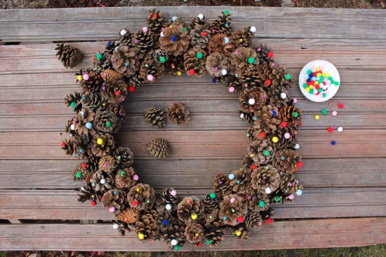 DIY pinecone wreath with pompoms (via makeanddocrew.com)