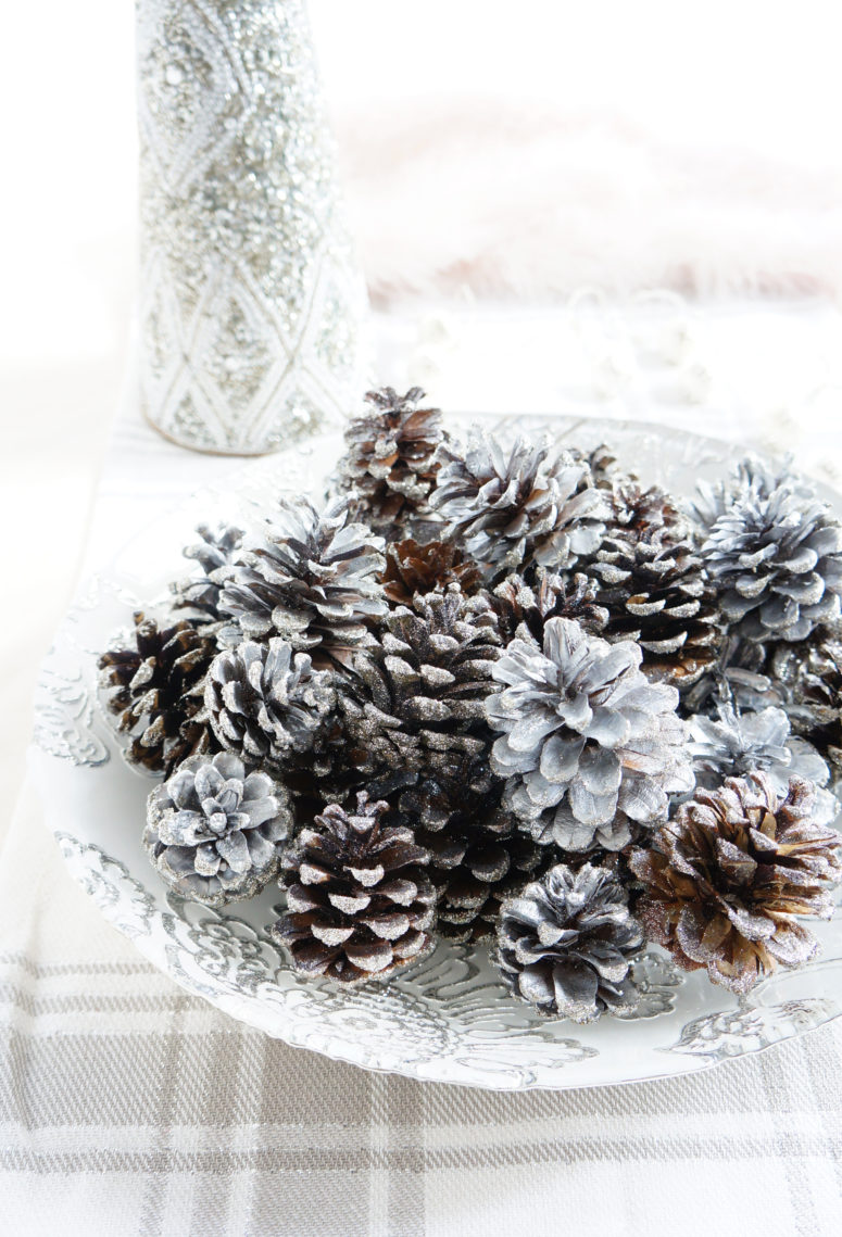 DIY sparkly pinecone display (via hauteandhealthyliving.com)