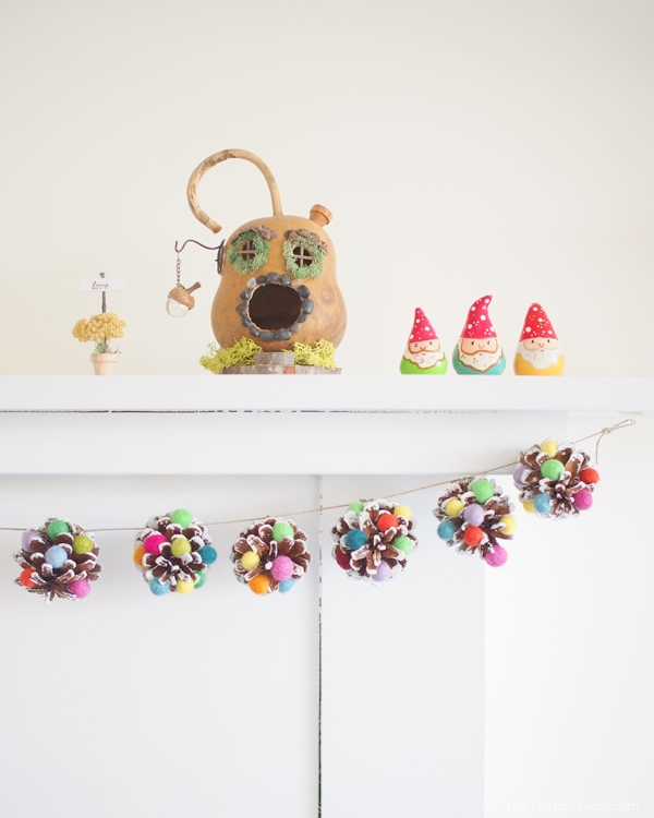 DIY sugarplum Christmas pinecone garland (via www.shelterness.com)