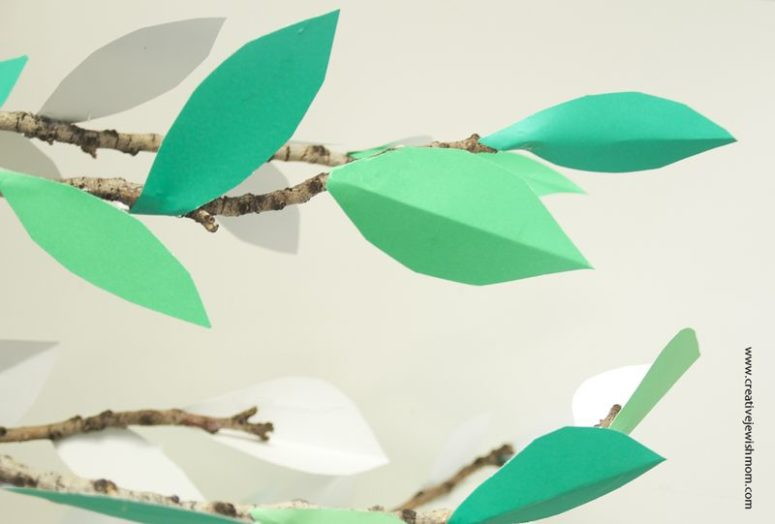DIY real branches with paper leaves (via www.creativejewishmom.com)
