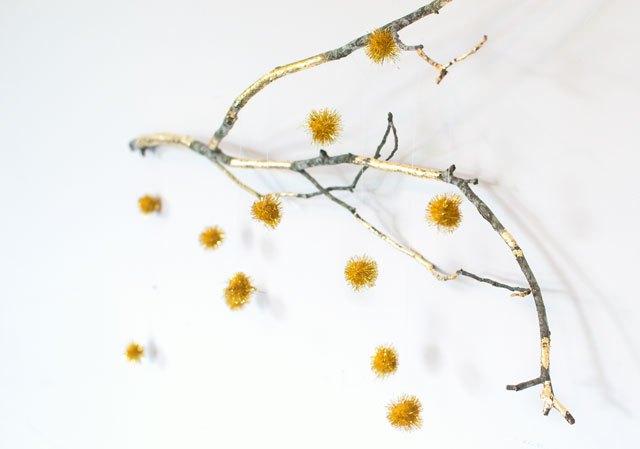 DIY gold gild branch with pompoms (via homeologymodernvintage.com)