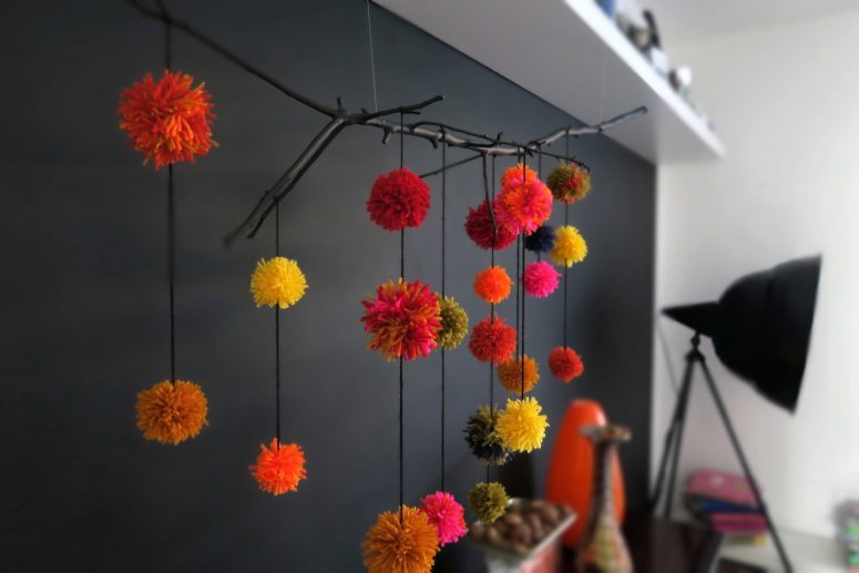 DIY branch and pompom wall decoration (via https:)