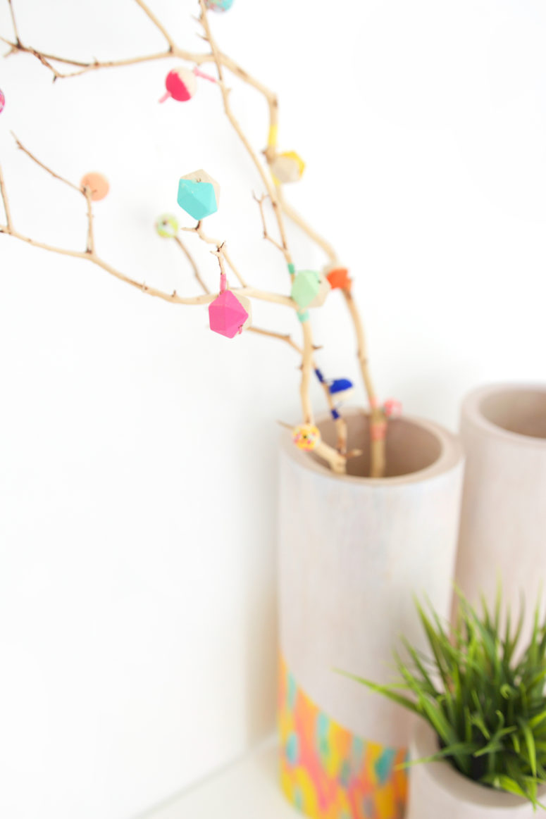 DIY twiggy branch with wooden beads (via damasklove.com)