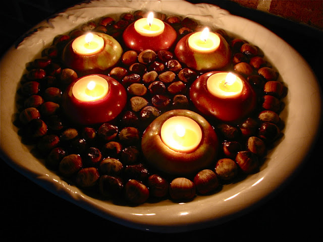 DIY floating chestnuts and apples with candles for a centerpiece (via hymnsandverses.com)