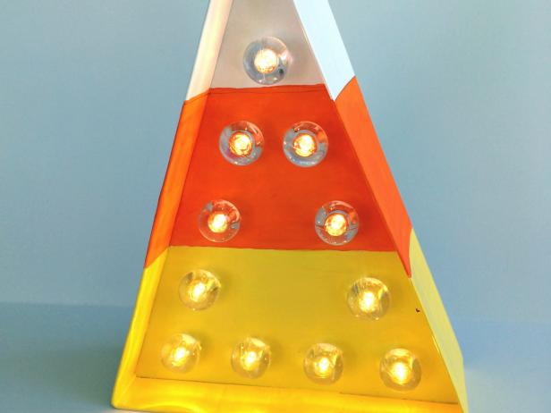 DIY marquee candy corn triangles for Halloween (via www.diynetwork.com)