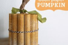 DIY rolled book paper pumpkin tied with strings