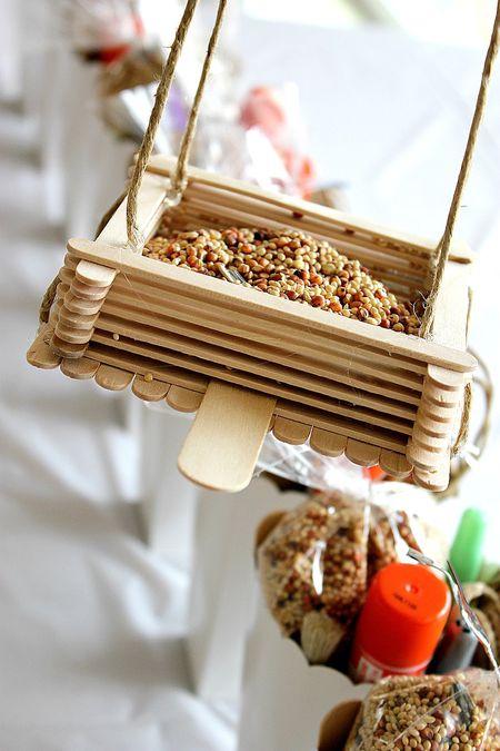 DIY bird feeders made of popsicle sticks (via www.tonyastaab.com)