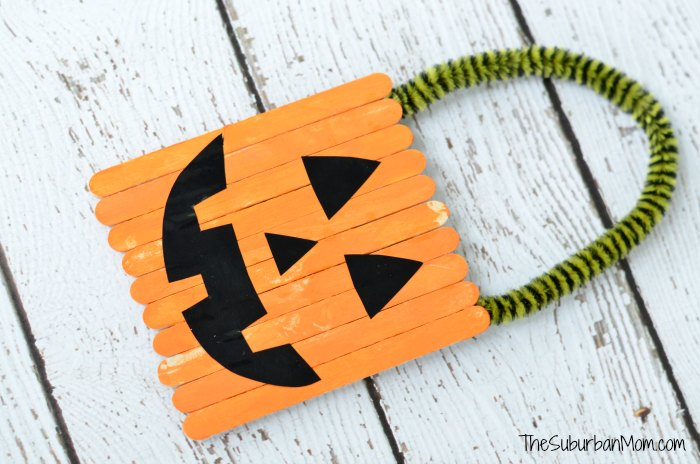 11 diy popsicle stick crafts for holidays shelterness diy halloween popsicle stick door hangers via thesuburbanmom solutioingenieria Choice Image