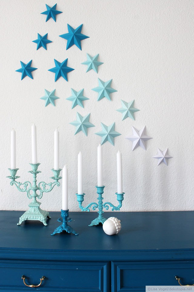 DIY 3D paper stars on the wall for Christmas (via www.dekotopia.net)