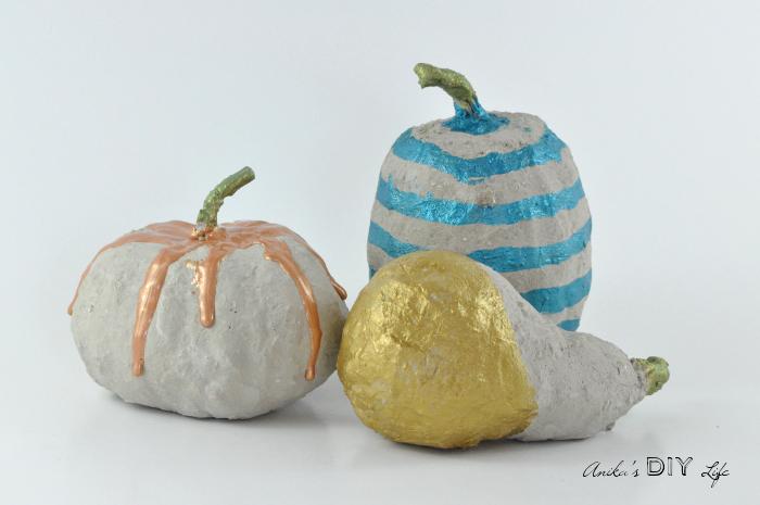 DIY painted concrete pumpkins for fall decor (via www.anikasdiylife.com)