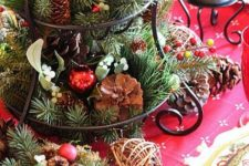 02 a cupcake stand with evergreens, pinecones and vine balls