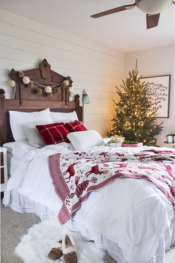 a lit up Christmas tree with no decor is a great idea for any bedroom & 21 Cozy Christmas Bedroom Décor Ideas - Shelterness