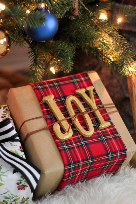 add plaid fabric to kraft paper, JOY letters and twine