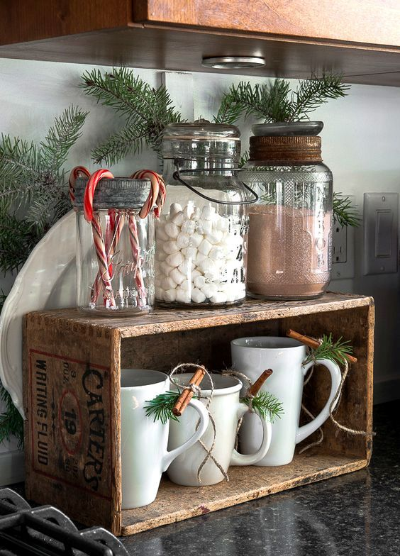 homemade hot cocoa station with jars and a crate