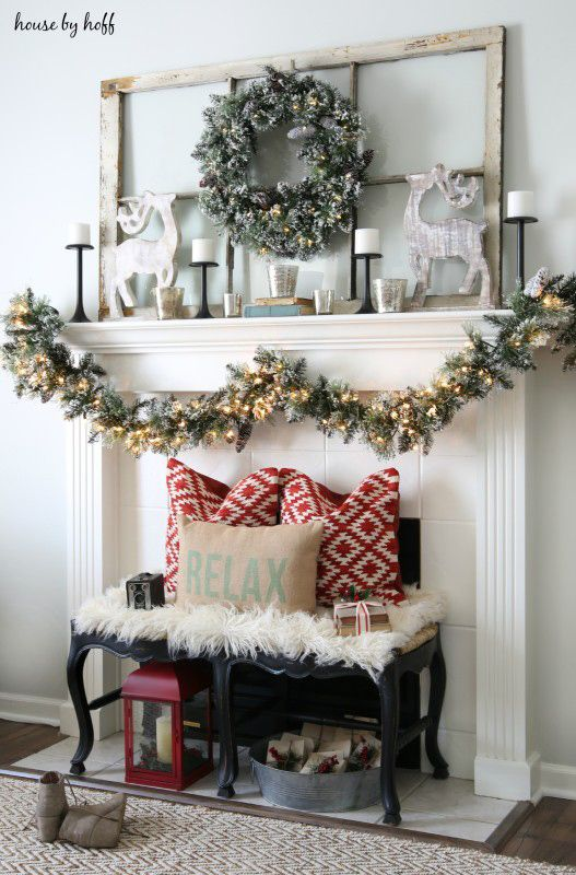 a faux evergreen garland and wreath with pinecones and lights